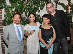 Vanessa Hudgens accepting on behalf of UNICEF Philippines, the $100,000 donation check by the Hollywood Foreign Press Association (HFPA) Members Ruben Nepales & Janet Nepales & HFPA President Theo Kingma to help in the Typhoon Haiyan relief efforts held at the Hollywood Foreign Press Association in West Hollywood, CA. The event took place on Thursday, December 12, 2013. Photo by Sthanlee B. Mirador_GMA | Pacific Rim Photo Press.
