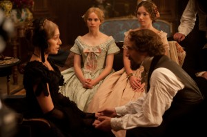 (l-r) Kristin Scott Thomas as Mrs. Ternan, Felicity Jones as Nelly Ternan, Perdita Weeks as Maria Ternan and Ralph Fiennes as Charles Dickens in THE INVISIBLE WOMAN. ©Sony Pictures Classics. CR: David Appleby.