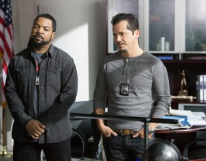 "(L to R) James (ICE CUBE) and fellow detective Santiago (JOHN LEGUIZAMO) in ""Ride Along."" ©Universal Pictures. CR: Quantrell D. Colbert."