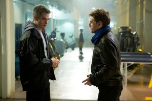 Left to right: Chris Pine (as Jack Ryan) discusses a scene with Director Kenneth Branagh on the set of JACK RYAN: SHADOW RECRUIT. ©Paramount Pictures. CR: Larry Horricks.
