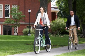 Edith (Vera Farmiga) and George (Andy Garcia) peddle their way through campus in AT MIDDLETON. ©Anchor Bay.