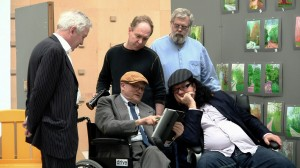 The filmmakers of TIM'S VERMEER gather with professor Philip Steadman and artist David Hockney in Hockney's studio in England. Standing, left to right: Professor Philip Steadman, director Teller and Tim Jenison. Seated left to right: artist David Hockney, producer Penn Jillette. ©High Deft Pictures. CR: Farley Ziegler.