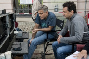 Director/writer/producer George Clooney (left) and producer/writer Grant Heslov on the set of Columbia Pictures' THE MONUMENTS MEN. ©Columbia Pictures. CR: Claudette Barius.
