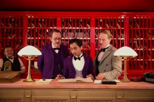 (l-r) Tom Wilkinson, Tony Revolori and Owen Wilson in THE GRAND BUDAPEST HOTEL. ©20th Century Fox. CR: Martin Scali