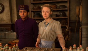 (l-r) Tony Revolori and Saoirse Ronan in THE GRAND BUDAPEST HOTEL. ©20th Century Fox. CR: Martin Scali.