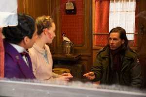 Director WES ANDERSON (right) with TONY REVOLORI and SAOIRSE RONAN on the set of THE GRAND BUDAPEST HOTEL. ©20th Century Fox. CR: Martin Scali.