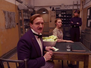 (l-r) RALPH FIENNES, TONY REVOLORI and SAOIRSE RONAN star in WES ANDERSON'S THE GRAND BUDAPEST HOTEL. ©20th Century Fox. CR: Bob Yeoman
