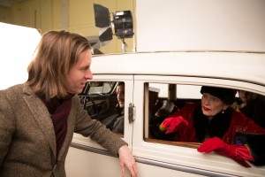 (l-) Director WES ANDERSON and TILDA SWINTON on the set of THE GRAND BUDAPEST HOTEL. ©20th Century Fox. CR: Martin Scali.