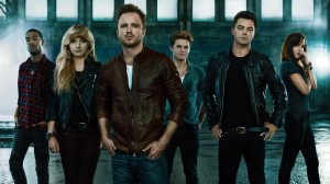 Left to Right) Scott Mescudi,  Imogen Poots,  Aaron Paul,  Harrison Gilbertson,  Dominic Cooper and Dakota Johnson star in Scott Waugh's NEED FOR SPEED. ©DreamWorks II Distribution Co., LLC. CR: Anthony Mandler.