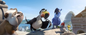 "In Rio, (left to right) Luiz (Tracy Morgan), Rafael (George Lopez), Blu (Jesse Eisenberg), Pedro (will.i.am) and Nico (Jamie Foxx) discuss their plans for the future in the animated film ""RIO 2,"" directed by Carlos Saldanha. ©20th Century Fox. CR: Blue Sky Studios."