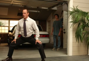 Frankie (Connor Buckley, R) watches Jack (Christopher Meloni, L) stretch in SURVIVING JACK. ©Fox Broadcasting Co. Cr: Mike Yarish/FOX