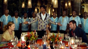(L-r) DREW BARRYMORE as Lauren, TERRY CREWS as Nickens with backup singers Thathoo played by JUNIOR MAMBAZO and ADAM SANDLER as Jim in BLENDED. ©Warner Bros. Entertainment.