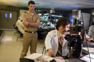 Dr.Trask (Peter Dinklage, seated) plots to eradicate the world of mutants in X-MEN: DAYS OF FUTURE PAST. ©Marvel/20th Century Fox. CR: Alan Markfield.