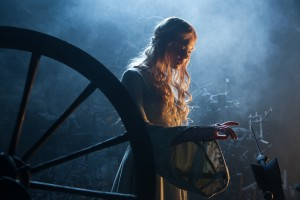 "Princess Aurora (Elle Fanning) about to touch the needle in Disney's ""MALEFICENT.""  ©Disney Enterprises. CR: Frank Connor."