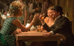 "(L to R) Anna (CHARLIZE THERON) has a few drinks with Louise (AMANDA SEYFRIED) and Foy (NEIL PATRICK HARRIS) in ""A Million Ways to Die in the West."" ©Universal Studios. CR: Lorey Sebastian."