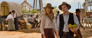 "Anna (CHARLIZE THERON) and Albert (SETH MACFARLANE) try not to die at the fair in ""A Million Ways to Die in the West."" ©Universal Studios."