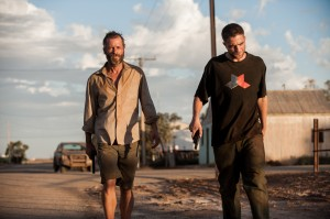 (l-r) Guy Pearce and Robert Pattinson in THE ROVER. ©A24Films.