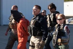 Arnold Schwarzenegger as Breacher, Joe Manganiello as Grinder, and Mireille Enos as Lizzy in SABOTAGE. ©Universal Studios. CR: Blake Tyers.