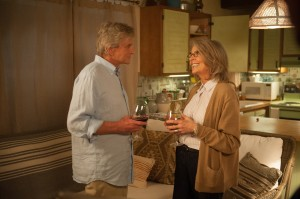 Oren (MICHAEL DOUGLAS) makes a move on Leah (DIANE KEATON) in AND SO IT GOES. ©Clarius Entertainment. CR: Clay Enos.