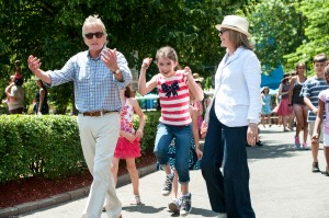 Oren (MICHAEL DOUGLAS), Sarah (STERLING JERINS) and Leah (DIANE KEATON) enjoy an afternoon at an amusement park in AND SO IT GOES. ©Clarius Entertainment. CR: Clay Enos.