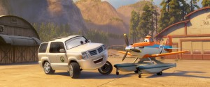 "(L-R) Cad Spinner (John Michael Higgins) and Dusty (Dane Cook) in ""PLANES: FIRE & RESCUE."" ©Disney Enterprises, Inc. All Rights Reserved."