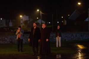 "(l-r) Chris O'Dowd as ""Jack Brennan,"" Gary Lydon as ""Gerry Stanton,"" Kelly Reilly as ""Fiona,"" and Brendan Gleeson as ""Father James"" in CALVARY. ©20th Century Fox. CR: Jonathon Hession."