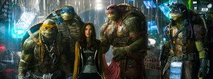 Left to right: Michelangelo, Leonardo, Megan Fox as April O'Neil, Raphael, and Donatello in TEENAGE MUTANT NINJA TURTLES, from Paramount Pictures and Nickelodeon Movies.
