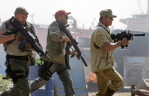 (From left to right) Toll Road (Randy Couture), Lee Christmas (Jason Statham) and Barney Ross (Sylvester Stallone) in THE EXPENDABLES 3. ©lionsgate. CR: Phil Bray.
