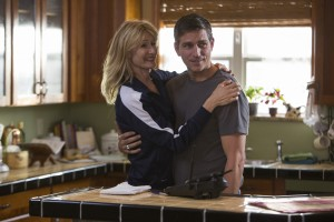 Laura Dern (left) and Jim Caviezel in TriStar Pictures' WHEN THE GAME STANDS TALL. ©CTMG. CR: Tracey Bennett.