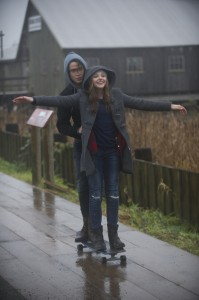 (l-r) JAMIE BLACKLEY as Adam and CHLOE GRACE MORETZ as Mia in IF I STAY. ©Warner Bros. Entertainment. CR: Doane Gregory.
