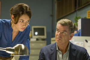 "Olga Kurylenko and Pierce Brosnan in ""The November Man.""  © 2014 No Spies, LLC. CRt: Aleksandar Letic"