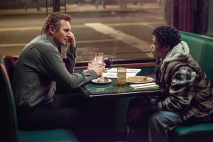 "(L to R) Matt Scudder (LIAM NEESON) discusses the case with TJ (BRIAN ""ASTRO"" BRADLEY) in A WALK AMONG THE TOMBSTONES. ©Universal Pictures. CR: Atsushi Nishijima."