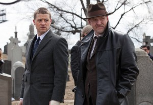 Detective James Gordon (Ben McKenzie, L) and Detective Harvey Bullock (Donal Logue, R) attend the Waynes' funeral in the Series Premiere of GOTHAM. ©Fox Broadcasting. CR: Jessica Miglio/Fox.