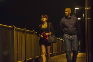 Teri (CHLOE GRACE MORETZ) and McCall (DENZEL WASHINGTON) walk across the bridge in Boston in Columbia Pictures' THE EQUALIZER. ©CTMG. CR: Scott Garfield.
