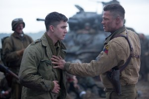 Wardaddy (Brad Pitt) with Norman (Logan Lerman) in Columbia Pictures' FURY. ©CTMG. CR: Giles Keyte.