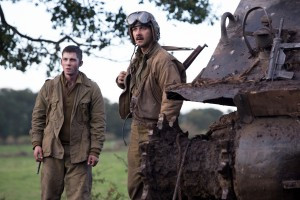 "Norman (Logan Lerman) and Boyd ""Bible"" Swan in Columbia Pictures' FURY. ©CTMG. CR: Giles Keyte."