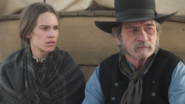 Hilary Swank Treks with Tommy Lee Jones in 'Homesman' – 4 Photos