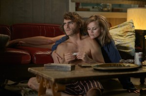 (l-r) Joaquin Phoenix as Doc Sportello and Reese Witherspoon as Hope Harlingen in INHERENT VICE. ©Warner Bros. Entertainment. CR: Wilson Webb.