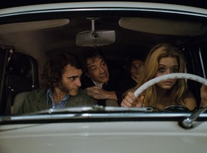 "(l-r) Joaquin Phoenix as Larry ""Doc"" Sportello, Martin Short as Dr. Rudy Blatnoyd, Jordan Christian Hearn as Denis and Sasha Pieterse as Japonica Fenway in INHERENT VICE. ©Warner Bros. Entertainment."
