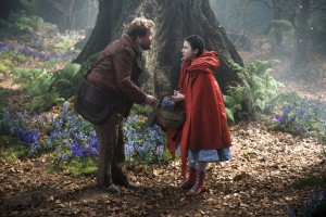 With James Corden as the baker and Lilla Crawford as Little Red Riding Hood, INTO THE WOODS. ©Disney Enterrpises. CR: Peter Mountain.