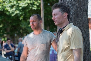 (L to R) Actor Jude Law and director Kevin Macdonald on the set of Focus Features upcoming adventure thriller BLACK SEA. ©Focus Features. CR:Alex Bailey.