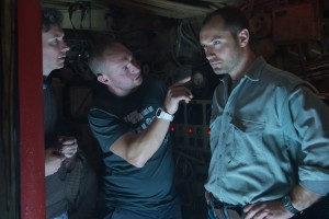 "(L to R) Director Kevin Macdonald; ""cinematographer Christopher Ross and actor Jude Law on the set of Focus Features' upcoming adventure thriller BLACK SEA. ©Focus Features. CR: Alex Bailey."