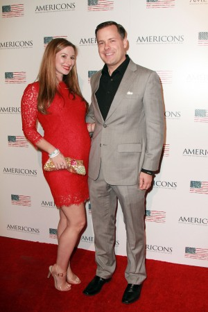Archstone Distribution President & CEO Brady Bowen and wife Brittany Bowen arrives on the red carpet of the premiere of AMERICONS held at the Arclight Theaters in Hollywood, CA on Thursday, January 22, 2015. ©Theresa Bouche