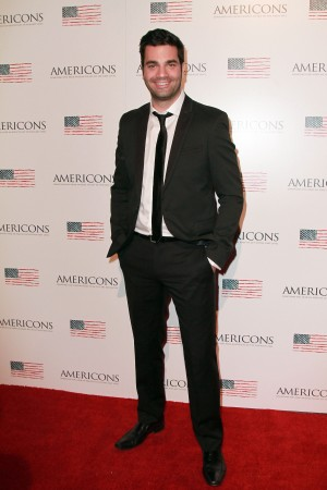 Producer Michael Masini arrives on the red carpet of the premiere of AMERICONS held at the Arclight Theaters in Hollywood, CA on Thursday, January 22, 2015. ©Theresa Bouche