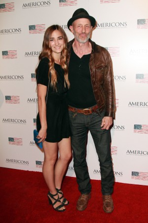 (L-R) Rose McConnell and Jon Gries arrives on the red carpet of the premiere of AMERICONS held at the Arclight Theaters in Hollywood, CA on Thursday, January 22, 2015. ©Theresa Bouche