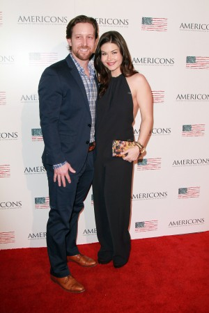 (L-R) Archstone Distribution Partner and Founder Scott Martin and wife Stephanie Beran arrives on the red carpet of the premiere of AMERICONS held at the Arclight Theaters in Hollywood, CA on Thursday, January 22, 2015. ©Theresa Bouche