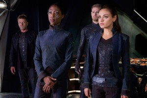 SEAN BEAN as Stinger Apini (far left), (middle background to right) CHANNING TATUM as Caine Wise and MILA KUNIS as Jupiter Jones in JUPITER ASCENDING. ©Warner Bros. Entertainment.