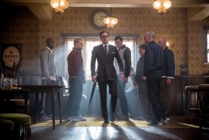 (center) Harry (Colin Firth), an elite member of a top-secret independent intelligence organization known as the Kingsman, prepares to teach some ruffians a lesson in KINGSMEN THE SECRET SERVICE. ©20th Century Fox. CR: Jaap Buitendijk.