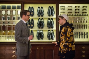 (l-r) Harry (Colin Firth), an impeccably suave spy, helps Eggsy (Taron Egerton) turn his life around by trying out for a position with Kingsman, a top-secret independent intelligence organization in KINGSMEN THE SECRET SERVICE. ©20th Century Fox. CR: Jaap Buitendijk.