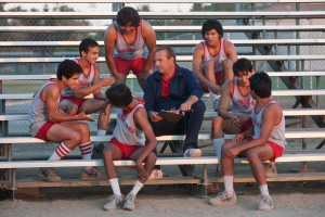 (l-r) Johnny Sameniego (Hector Duran), Victor Puentes (Sergio Avelar), Damacio Diaz (Michael Aguero), Danny Diaz (Ramiro Rodriguez), Coach Jim White (Kevin Costner), Jose Cardenas (Johnny Ortiz), Thomas Valles (Carlos Pratts) and David Diaz (Rafael Martinez) in MCFARLAND, USA. ©Disney Enterprises. CR: Ron Phillips.